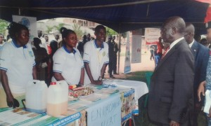Program Interns - WASH, Angella and Ronald together with the chairperson, Zibulatudde CBO receive the prime minister, Edawrd Ssekandi at Environment Alert's stall during the handwashing day festival in Luweero